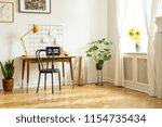 spacious home office interior...   Shutterstock . vector #1154735434