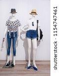 full length two mannequin in... | Shutterstock . vector #1154747461
