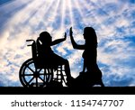 silhouette of a happy disabled... | Shutterstock . vector #1154747707