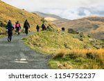 Group Of People Hiking To...