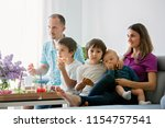 beautiful young family with... | Shutterstock . vector #1154757541