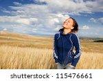 young woman enjoying nature | Shutterstock . vector #115476661