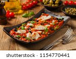 cod in italian in tomatoes with ... | Shutterstock . vector #1154770441