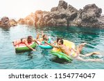happy friends floating with... | Shutterstock . vector #1154774047