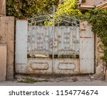 old rusty metal gate  close up | Shutterstock . vector #1154774674
