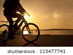 Silhouette Of Fit Cyclist In...