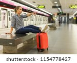 attractive girl traveler... | Shutterstock . vector #1154778427