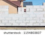 brick wall in a house under... | Shutterstock . vector #1154803837