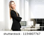 young secretary smiling in her... | Shutterstock . vector #1154807767