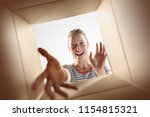 the surprised woman opening box ... | Shutterstock . vector #1154815321