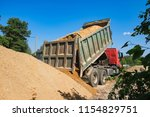 Rusovich Pours Sand On The...