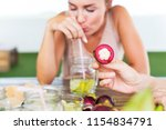 young cheerful woman drinking...   Shutterstock . vector #1154834791