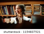 girl with pigtails in white... | Shutterstock . vector #1154837521