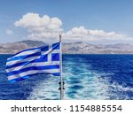 A Greek Flag Flapping With A...