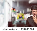 young crazy man as a chef... | Shutterstock . vector #1154899384