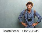 young handsome traveler man... | Shutterstock . vector #1154919034