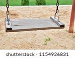 wood swings  swings chain... | Shutterstock . vector #1154926831