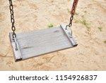 wood swings  swings chain... | Shutterstock . vector #1154926837