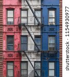 fire escapes of a colorful...   Shutterstock . vector #1154930977