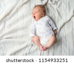 newborn baby lying on a white... | Shutterstock . vector #1154933251
