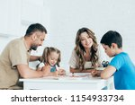 parents helping children with... | Shutterstock . vector #1154933734