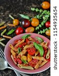 multicolored penne pasta with... | Shutterstock . vector #1154935654