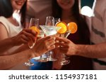 young people clinking glasses... | Shutterstock . vector #1154937181
