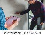 inspector checking point for ...   Shutterstock . vector #1154937301