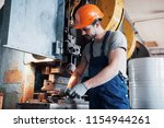 experienced operator in a hard... | Shutterstock . vector #1154944261