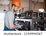 portrait of a young worker in a ... | Shutterstock . vector #1154944267