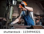 portrait of a young worker in a ... | Shutterstock . vector #1154944321