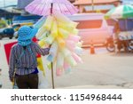 woman selling cotton candy | Shutterstock . vector #1154968444