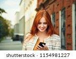 beautiful redhead woman in a... | Shutterstock . vector #1154981227