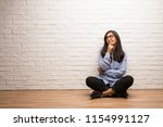 young indian woman sit against... | Shutterstock . vector #1154991127