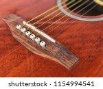steel string acoustic guitar... | Shutterstock . vector #1154994541