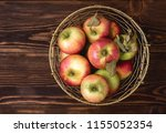 basket with apples fresh raw... | Shutterstock . vector #1155052354