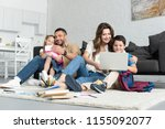 smiling father and daughter... | Shutterstock . vector #1155092077