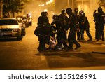 Small photo of BUCHAREST, ROMANIA - August 10, 2018: Riot police spray teargas while scuffling with protesters outside the government headquarters, in Bucharest, Romania, Friday, Aug. 10, 2018.
