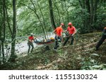 search and rescue team helping... | Shutterstock . vector #1155130324