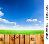 Wooden Fence Against Green...