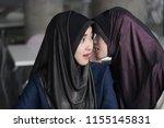 muslim woman gossip getting... | Shutterstock . vector #1155145831