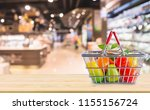 shopping basket with fruits on... | Shutterstock . vector #1155156724