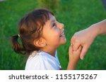 the little girl kisses the old... | Shutterstock . vector #1155175267