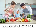 a happy family is preparing in... | Shutterstock . vector #1155189694