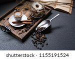 coffee beans and a cup of latte ... | Shutterstock . vector #1155191524