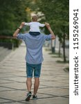 a father with a small daughter... | Shutterstock . vector #1155269041