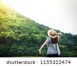 beautiful woman relaxing on... | Shutterstock . vector #1155322474