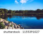 an artificial dam created on a... | Shutterstock . vector #1155391027