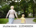 beautiful granny and her little ... | Shutterstock . vector #1155400054