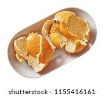 tangerine on plate.  preparing...   Shutterstock . vector #1155416161